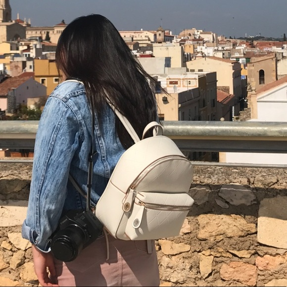 Zara Handbags - Zara white faux quilted leather backpack